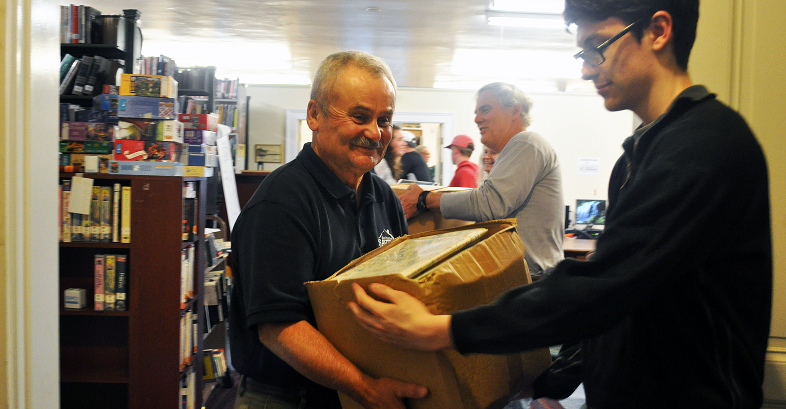 The entire team went and hauled books for the Jesup Memorial Library book sale and fund-raiser. Shown: Bill Weir