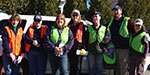 The BHS&L team pitches in at Friends of Acadia's Earth Day Roadside Cleanup. From left to right: Nancy Sawyer, Ardette Spear, Rhonda Sawyer, Jacquie Colburn, Michael Pritchard with his wife and daughter, and Vicky Vendrell